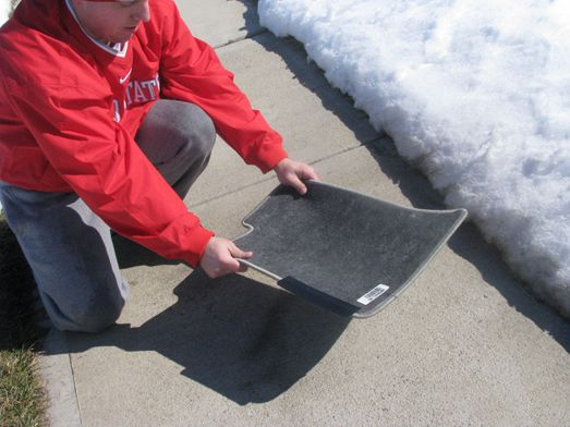 Cleaning Dust From Car Floor Mats by Whacking and Shaking